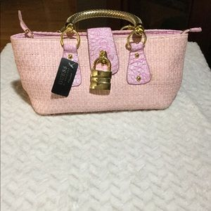 Pink weave Guess purse